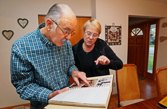 Dennis Gall and his wife Sharon of Grafton look at historical photos of a family his father befriended in Italy while fighting during World War II. Years later, his family is still in touch with that faraway family and they made a visit over there this fall.