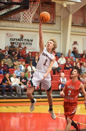 Norfork's Dawson Gray goes up for two against Rural Special on Monday night.