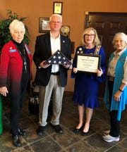 The Captain Nathan Watkins Chapter of the Daughters of the American Revolution recently presented Chief Carry Manuel of the Mountain Home Police Department with an American flag that was flown over D.A.R. Headquarters in Washington, D.C., on Veterans Day in thanks for protecting our community and preserving our constitutional rights. Pictured above are (left to right) Vice Regent Joanne Dukes, Police Chief Carry Manuel, Registrar Caroline Carroll and Regent April Baily.