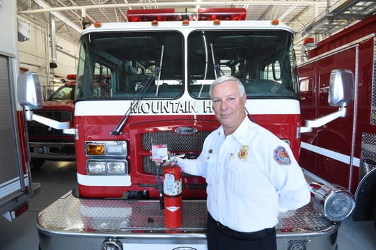 Mountain Home Fire Marshal Gary Pyszka displays two of the most important fire safety items every home should have, smoke detectors and fire extinguishers.