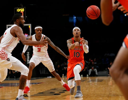 Nov 25, 2019; Brooklyn, NY, USA; Auburn Tigers guard Samir Doughty (10) passes the ball against New Mexico Lobos guard Keith McGee (3) in the first half of the Roman Legends Classic at Barclays Center. Mandatory Credit: Nicole Sweet-USA TODAY Sports