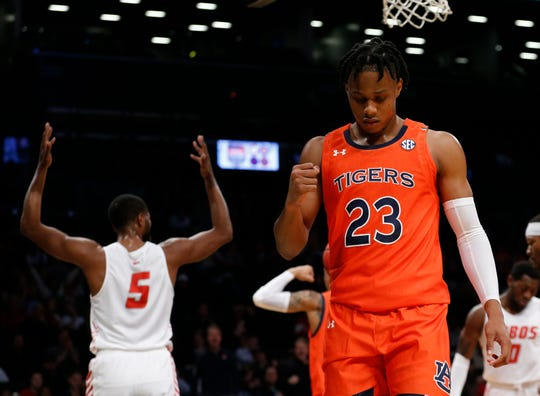 Auburn forward Isaac Okoro (23) reacts after making a play against New Mexico guard JaQuan Lyle at the Legends Classic in Brooklyn on Nov. 25, 2019.