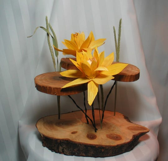 "Karen Ford of Yorktown won second-place in the 3D Category in Fusion Art's 5th Annual Leaves and Petals International Art Exhibition for her entry, ""Waterlilies."""