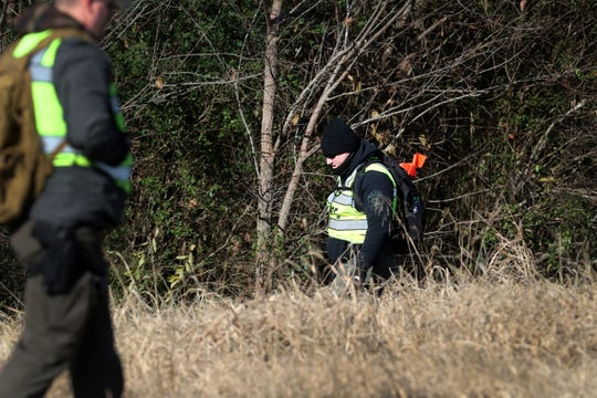 Officials search along Barfield Crescent Road near Veterans Parkway for evidence in the disappearance of Murfreesboro teen Devin Bond on Nov. 13.
