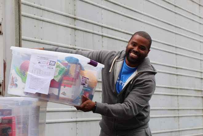 United Way individual and business volunteers, such as Experian, from around the county helped to deliver Thanksgiving baskets to almost 1,000 families this week.