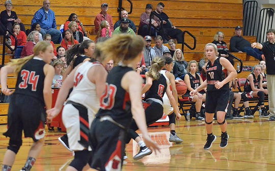 The Fairview Middle Lady Falcons power down the court against the Hickman Lady Dawgs on Nov. 18.