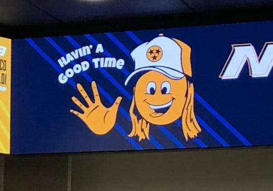 A cartoon inspired by comedian Dusty Slay is on the digital signage atop a wall in the Predators' locker room. It features a team slogan adopted for the 2019-20 season.