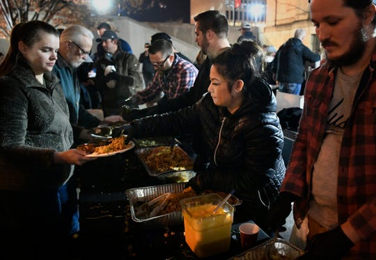 Some of Nashville's top chefs including Nina Singto, Thai Esane, second from right, are jumping into a longtime Monday night program that provides free meals and other services for the homeless. Monday, Nov. 25, 2019, in Nashville, Tenn.