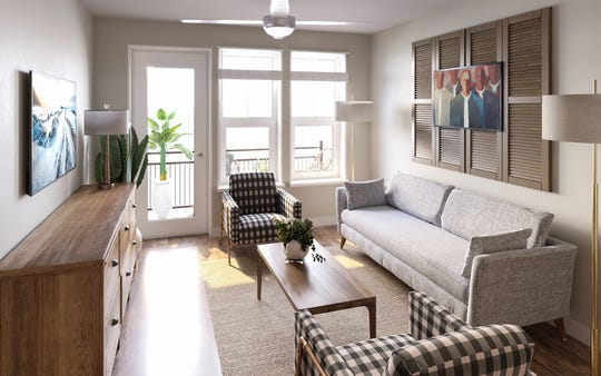 This living room at Harpeth Square has direct access to a balcony. Some apartments have views of the Harpeth River.