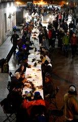Residents sit in preparation for dinner as the Monday night program (People Loving Nashville) provides free meals for the homeless. Monday, Nov. 25, 2019, in Nashville, Tenn.