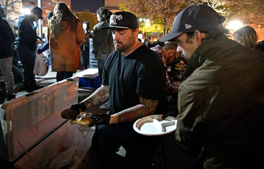 Some of Nashville's top chefs, including Shane Nasby, HoneyFire BBQ, are jumping into a longtime Monday night program (run by nonprofit People Loving Nashville) that provides free meals and services for the homeless. Top restaurants will cook and deliver the meals, leaving more money for clothes and showers and more. Monday, Nov. 25, 2019, in Nashville, Tenn.
