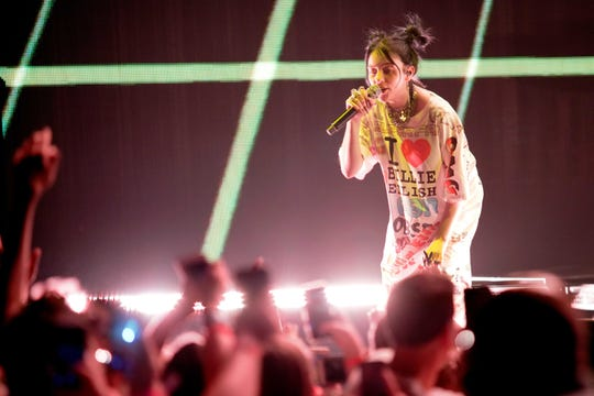 """Billie Eilish performs during the """"When We All Fall Asleep"""" tour at the United Center in Chicago on June 9, 2019."""