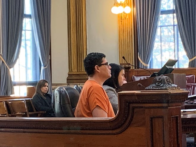 Joshua Metoxen (center) sits beside his attorney, Diane Menashe, during a hearing in Licking County Common Pleas Court on Tuesday, Nov. 26, 2019. Metoxen was sentenced to an indefinite sentence of 3-4.5 years in prison after he admitted to causing his infant son's injuries.