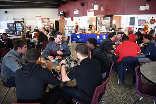 This is the last year for the Clifton-Passaic Thanksgiving Day game. Each year there's a sportsmanship breakfast hosted by the home team, which makes this the final sportsmanship breakfast. (Left) Clifton HS Football Coach Ralph Cinque talks with his players during the breakfast at Clifton High School on Tuesday, November 26, 2019.