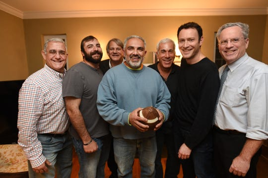 Group photo of the friends who have met every year since 1967 to play football on Thanksgiving (L to R), Brad Chananie, Jonathan Chananie, Scott Reddin, Marco Rodriguez, Scott Harris, Ethan White and Ron White, photographed in Englewood on 11/25/19.
