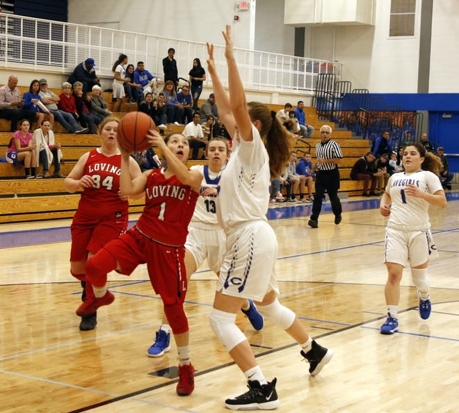 Loving's Tiana Rodriguez goes for a contested shot against the Carlsbad JV on Nov. 25, 2019.