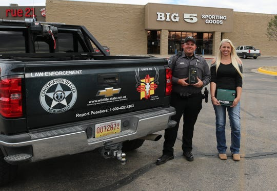New Mexico Game and Fish Warden Don Norton (left) and Kristy Maley of the Eddy County Mule Deer Foundation display equipment used to help officers catch poachers.