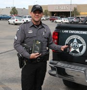 Sgt. Josh Waldrip of the New Mexico Department of Game and Fish displays a piece of equipment donated by the Eddy County Mule Deer Foundation to help officers catch potential animal poachers.