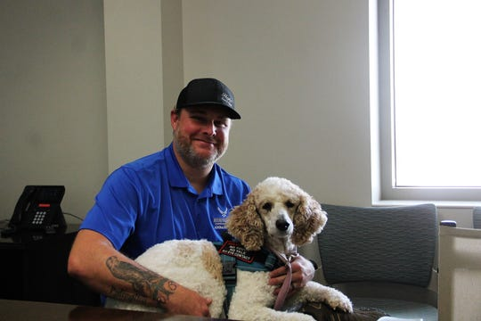 Air Force Wounded Warrior Ambassador Mathew Buzzard and his service dog Lexi.