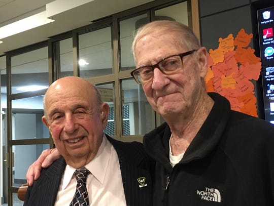 Guy Stern (left) and a fellow military man, Col. Carmelo Milia, share memories following Stern's lecture on little known heroes of World War II, the Ritchie Boys. Those young German immigrants served as U.S. military interrogators and saved thousands of American lives.
