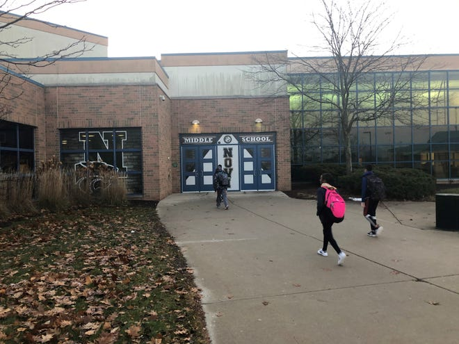 Students enter Novi Middle School at the start of the day on Nov. 26, 2019. The district has approved a 45-minute later start time at both the middle school and high school.