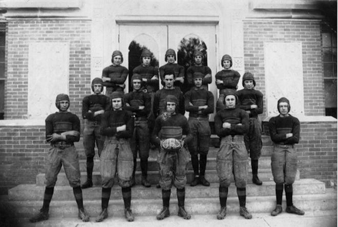 Members of the Opelousas High School Football Team of 1922 were in full gear for this photo taken at the high school.  Team members are left to right:  (front row) Lee Garland, Earl Guedry, Lloyd Reynolds, Noah Guedry, Sidney Bertheaud; (center row) Lee Robin, Edmond Pavy, Coach Sam Moncla, Havlin Haw, Elden Voorhies; (third row) Arthur Sanders, Creighton Shute, Ivan Holman, Henry Pitre and Victor Andrepont.  (*Photo identification by Mrs. Martin Roy, Jr.)