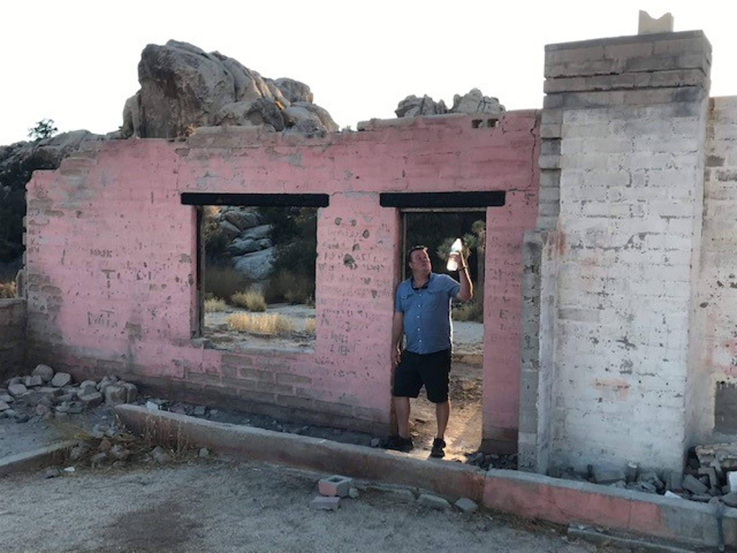 UC Riverside doctoral candidate Todd Luce stands in the remnants of the Bagley-Ohlson home site in Joshua Tree National Park. He is preparing a report on the history of private property in the 800,000 acre preserve.