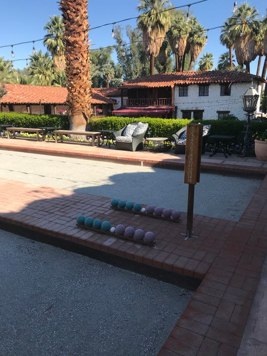 Bocce ball courts overlook some of the original hacienda buildings at Tradition Golf Club in in La Quinta