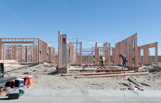 Flair homes by Woodbridge Pacific Group are being constructed inside the Miralon development in Palm Springs, Calf., on Monday, November 26, 2019. The development will include olive orchards, which residents are to receive a share of the pressed oil.