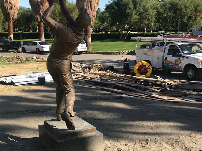 A statue of Arnold Palmer overlooks some of the construction activities at Tradition Golf Club in La Quinta, where Palmer lives part time.