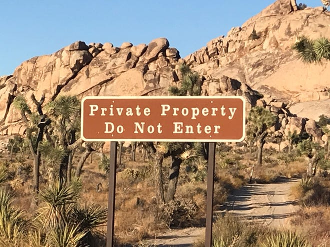 About a dozen private homes or remains of homes sit inside Joshua Tree National Park.