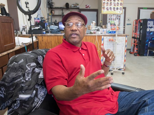 Pastor James Blevins talks Tuesday about challenges contributing to unemployment in the black community.