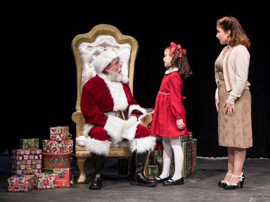"From left, Doug Holsworth portrays ""Kris Kringle"", Mattie Barber portrays ""Susan"", and Michele Barber portrays ""Doris"" during the staging of Miracle on 34th Street at the Pensacola Little Theatre in Pensacola on Monday, Nov. 25, 2019."