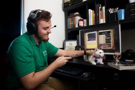 """Hunter Lyons, a computer science major and the SGA director of internal affairs, plays one of his favorite video games, """"Spelunky,"""" in his home on Nov. 22."""