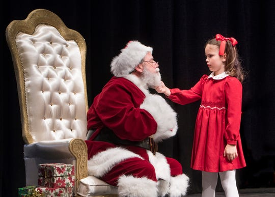 "Doug Holsworth portrays ""Kris Kringle"", left, and Mattie Barber portrays ""Susan"" during the staging of Miracle on 34th Street at the Pensacola Little Theatre in Pensacola on Monday, Nov. 25, 2019."