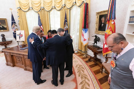 Navajo Nation Vice President Myron Lizer provides a prayer in the Oval Office before President Donald Trump signed an executive order to establish a task force on Missing and Murdered American Indians and Alaska Natives on November 26, 2019.