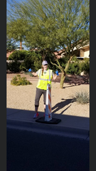 Mandi Wirtala sets up a sign on the Ragnar Del Sol course, a relay race from Wickenburg to Mesa, in 2018. About 180 teams of between six and twelve people registered for last year's race, according to race director Jonathan Embler.