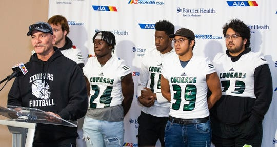 Phoenix Christian coach Brian Cole with his players during AIA state football championships media day.