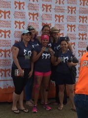 Mandi Wirtala (back left, in a cowboy hat) poses for a photo with her team, named the Galloping Gazelles Gunship, after completing the Ragnar Del Sol relay race in 2015.