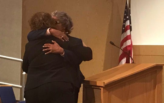 Councilman Anita Ashford hugs Port Huron Parks and Recreation Director Nancy Winzer during City Council's meeting on Monday, Nov. 25, 2019.