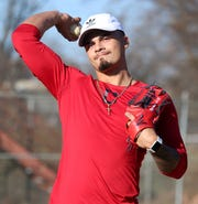 Lenny Torres throws at the baseball field beside his home in Beacon on November 26, 2019. Torres was drafted by the Cleveland Indians in 2018 and injured his elbow in April 2019.
