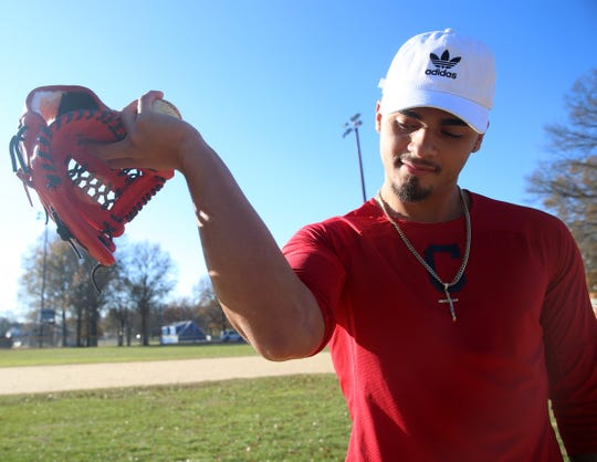 Lenny Torres looks at his scar from Tommy John surgery at a baseball field near his home in Beacon on November 26, 2019. Torres was drafted by the Cleveland Indians in 2018 and injured his elbow in April 2019.