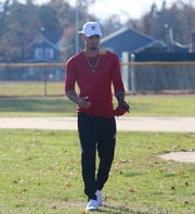 Lenny Torres at the baseball field beside his home in Beacon on November 26, 2019. Torres was drafted by the Cleveland Indians in 2018 and injured his elbow in April 2019.