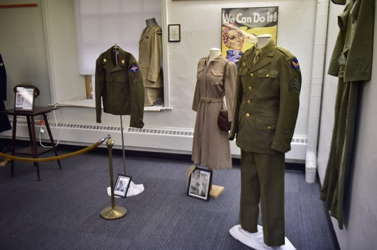 Ann Hall has been working at the Franklin County Historical Society for most of her career. Building displays can be challenging, but a part of the job she looks forward to. Here is a set-up of local uniforms from those who served in World War II.