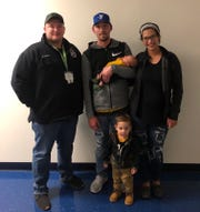 Franklin County 911 dispatcher Brady Strite, left, pictured with Jared Ross, Janice Flagle and their sons, newborn Titen and 1-year-old Teegen.