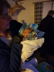 Jared Ross' mom holds Titen soon after his birth in the first hour of Oct. 24.