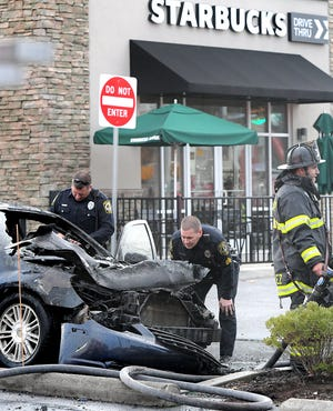 Police and firefighters respond to a vehicle fire outside outside of a Starbucks in York Township on Springwood Road Tuesday, Nov. 26, 2019. Bill Kalina photo