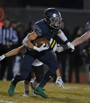 Damonte's Ashton Hayes carries the ball against Bishop Manogue during Monday's regional championship game.