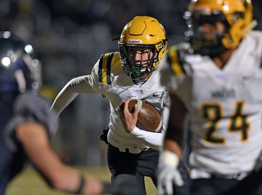 Bishop Manogue quarterback Drew Scolari runs with the ball against Damonte in the regional Championship game at Reno High.