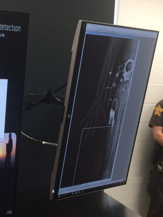 A scan of Sgt. Christopher Toby shows items Toby was carrying on his right side, including his handcuffs and keys, during a demonstration of the Wayne County Jail's body scanner Tuesday.